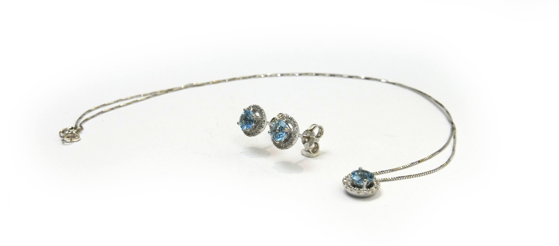 Collana ed orecchini in oro bianco, con acquamarina e diamanti