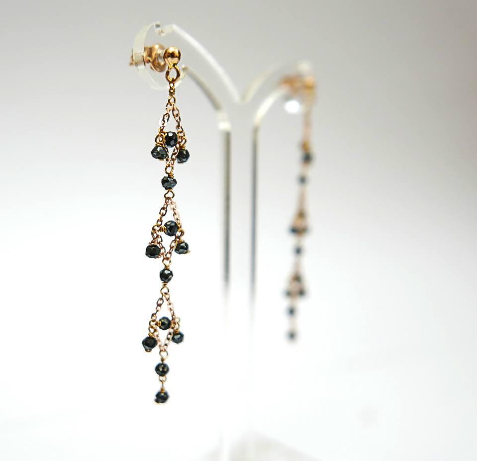 Orecchini in oro rosa con diamanti neri daniele pifferi - laboratorio orafo e gioielleria bologna