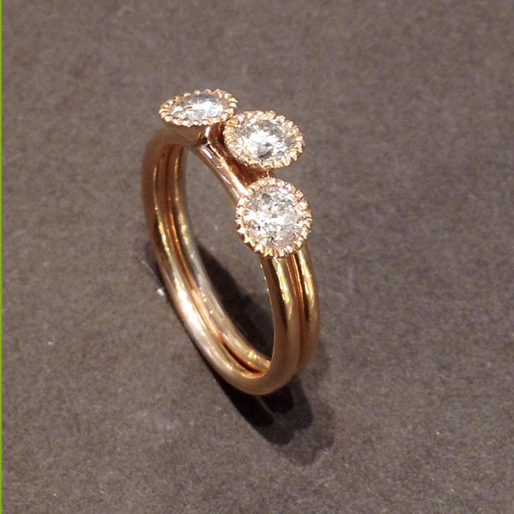 Trilogy composto da due anelli in oro rosa e diamanti brown